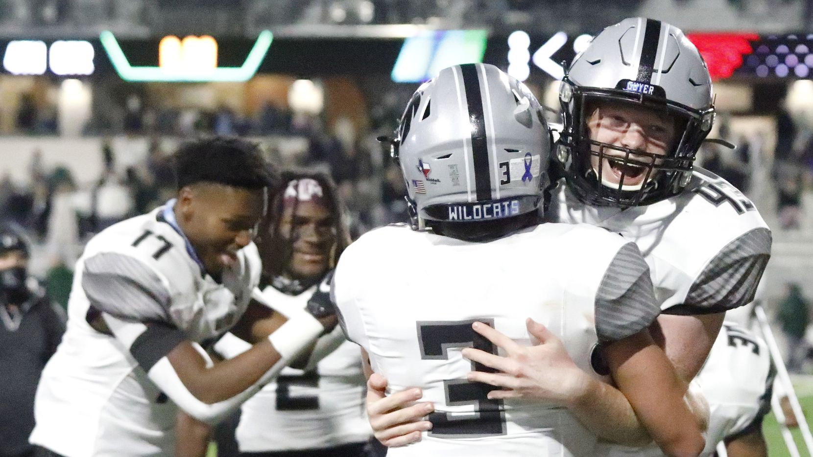 Denton Guyer High School kicker Michael Mayfield (43) is embraced by Denton Guyer High School quarterback Eli Stowers (3) after Mayfield kicked the winning extra point with no time left on the clock at the end of the game as Prosper High School hosted Denton Guyer High School in a District 5-6A football game at Children's Health Stadium in Prosper on Friday night, October 30, 2020.