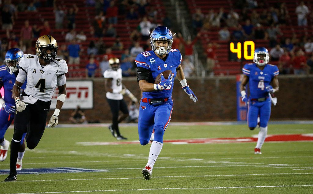 SMU defensive back Jordan Wyatt (15) returns an interception for a touchdown past UCF wide receiver Tre'Quan Smith (4) during the second quarter at Gerald J. Ford Stadium on Saturday, Nov. 4, 2017, in Dallas. (Jae S. Lee/The Dallas Morning News)