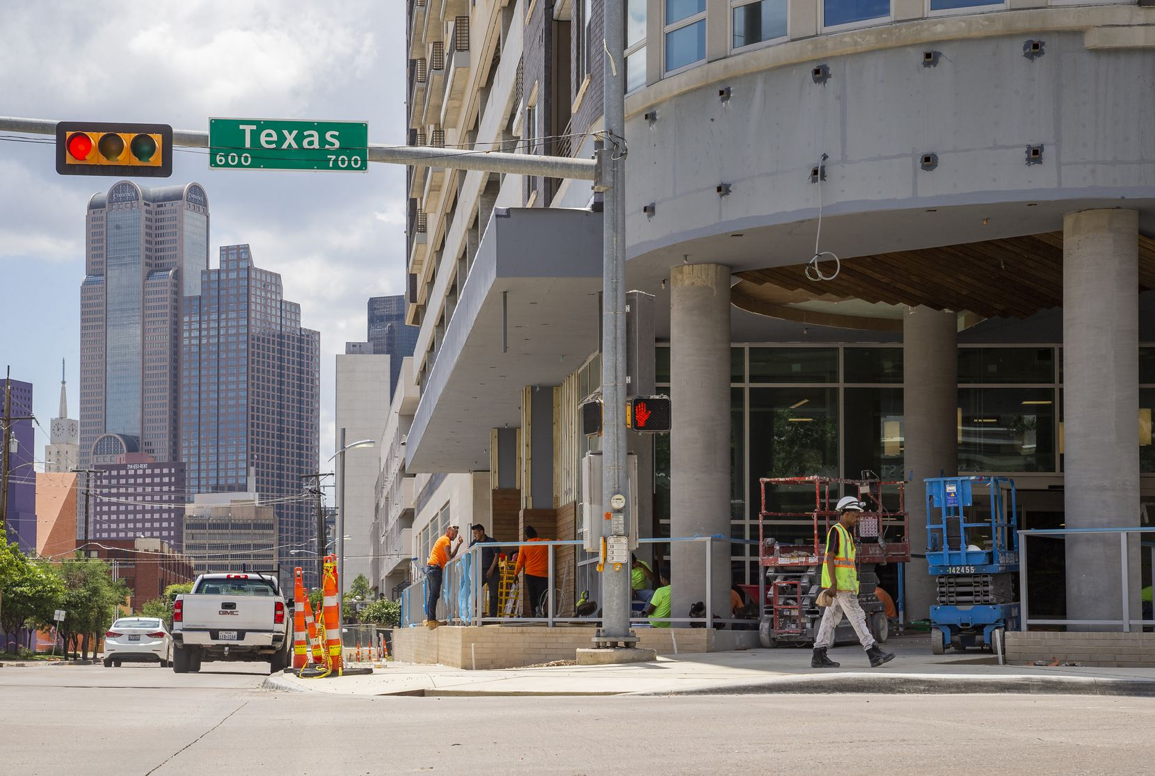 Downtown can be seen in the background of the Tom Thumb being built at Live Oak and Texas streets.