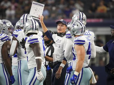 Dallas Cowboys special teams coordinator John Fassel send in a play during the first half of a preseason NFL football game against the Jacksonville Jaguars at AT&T Stadium on Sunday, Aug. 29, 2021, in Arlington.