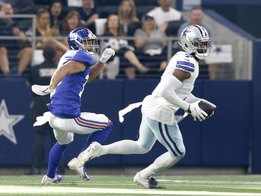 Dallas Cowboys cornerback Trevon Diggs (7) intercepts a pass intended for New York Giants wide receiver C.J. Board (18) in the third quarter at AT&T Stadium in Arlington, Texas, Sunday, October 10, 2021.