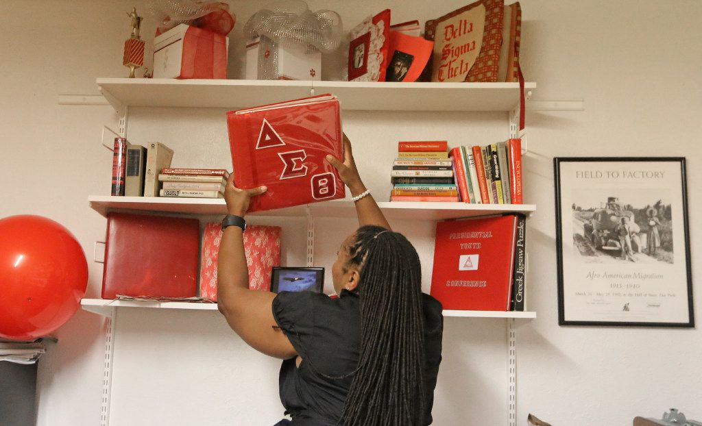 Amye Thompson Hollins, president of local chapter of Delta Sigma Theta Sorority, looks at one of the scrapbooks stored at the sorority house in Dallas.