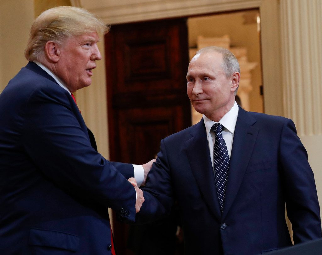 President Donald Trump, left, and Russian President Vladimir Putin shake hands at the conclusion of their joint news conference at the Presidential Palace in Helsinki, Finland, on Monday, July 16, 2018. (AP Photo/Pablo Martinez Monsivais)
