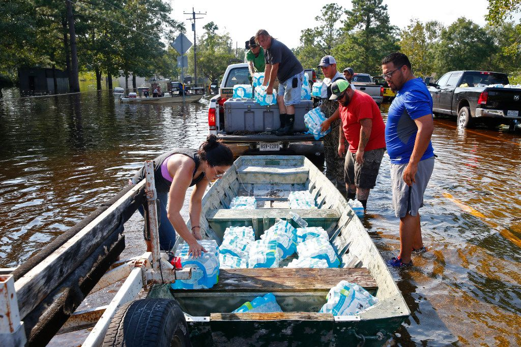 Volunteers load up boats to resupply Pine  Forest after Hurricane Harvey near Vidor, Texas, on Sunday.