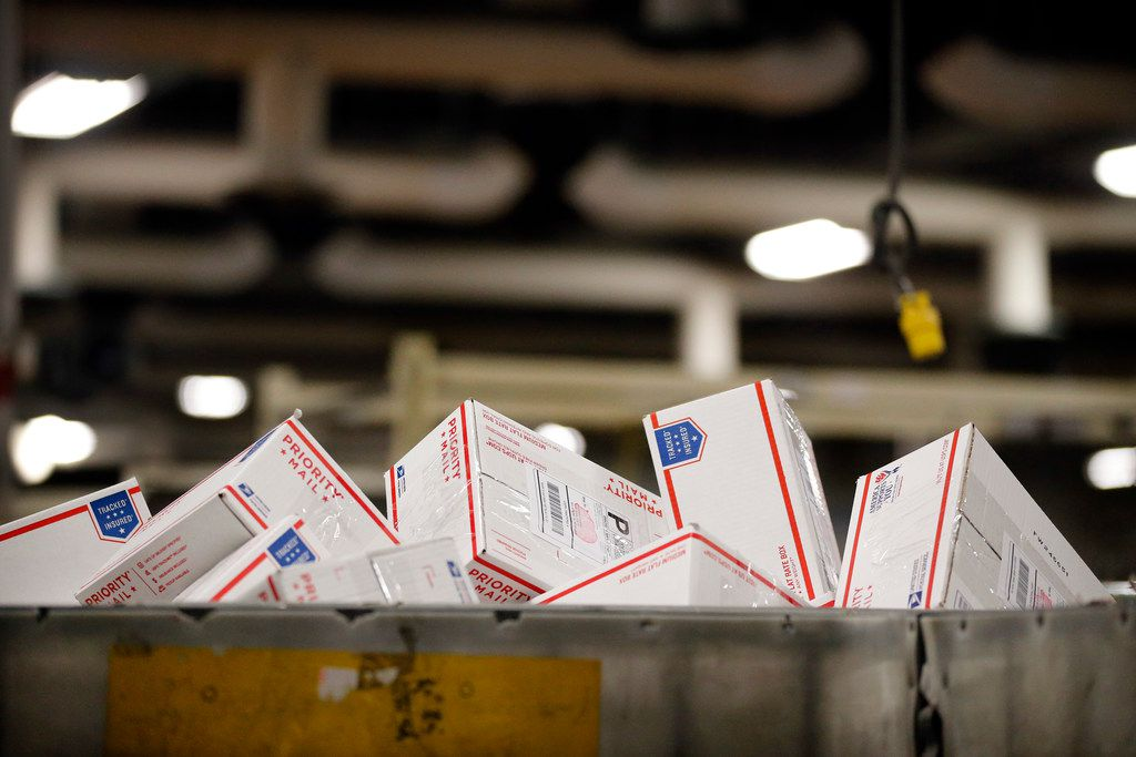 Priority Mail parcels fill a large container at the US Postal Service's North Texas Processing & Distribution Center in Coppell, Texas, Thursday, December 14, 2017.