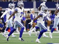Dallas Cowboys strong safety Damontae Kazee (18) and Trevon Diggs (7) celebrate an early third down stop of the Philadelphia Eagles offense during the first quarter at AT&T Stadium in Arlington, Monday, September 27, 2021.