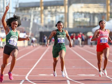 DeSoto's Ja'Era Griffin (center) places fifth during her 6A Girls 100 meter run at the UIL state track meet at the Mike A. Myers Stadium, at the University of Texas on May 8, 2021 in Austin, Texas. Jasmine Montgomery of San Antonio Reagan (left) won first place.
