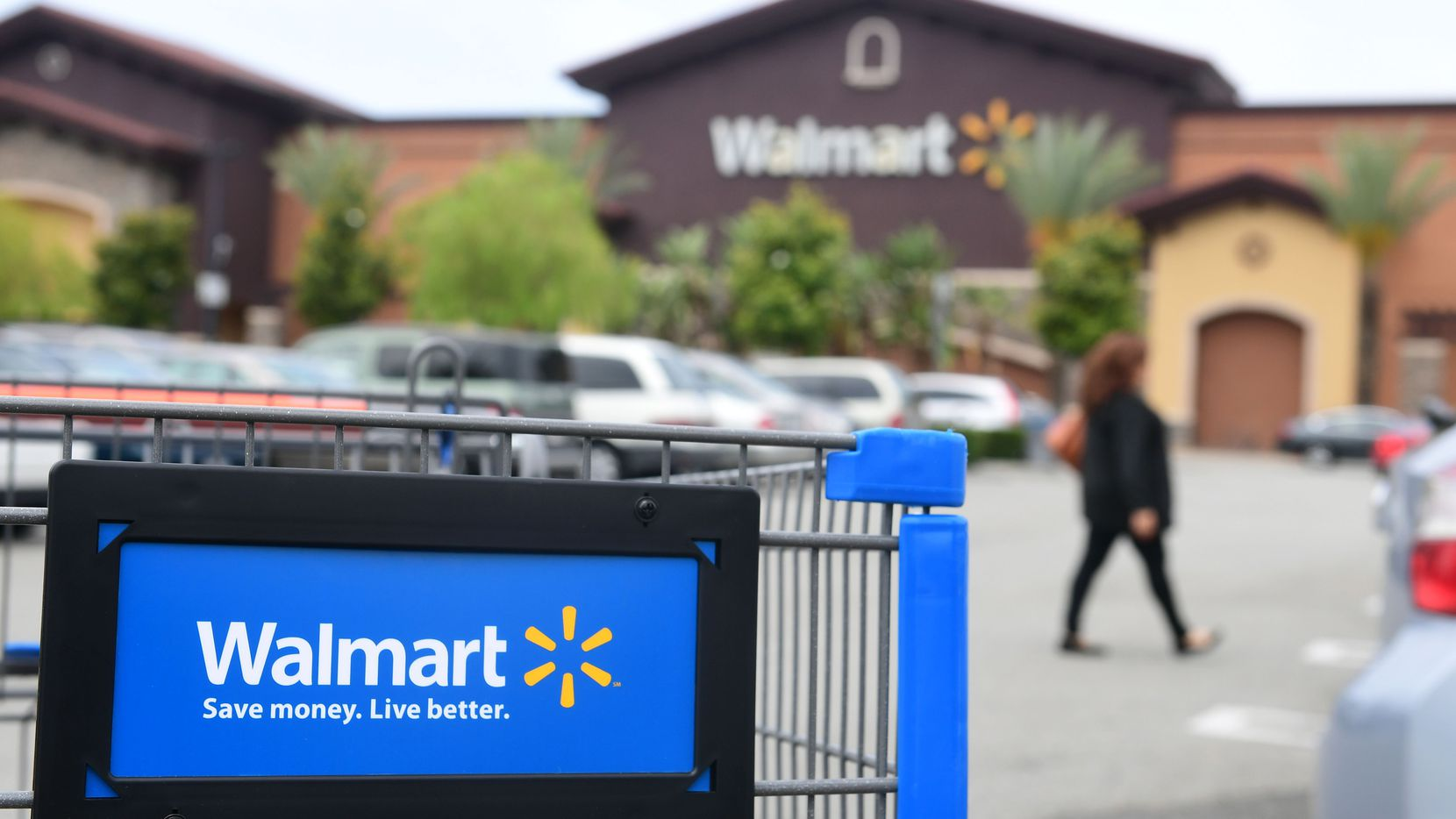Walmart is imposing employee travel restrictions and canceling a conference next week in Dallas.