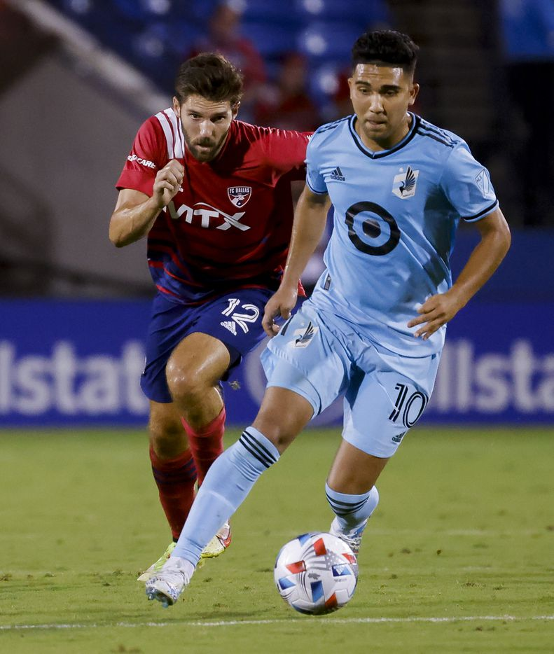 FC Dallas midfielder Ryan Hollingshead (12) chases after Minnesota United midfielder Emanuel Reynoso (10) during the first half of a game on Saturday, Oct. 2, 2021, at Toyota Stadium in Frisco. (Juan Figueroa/The Dallas Morning News)