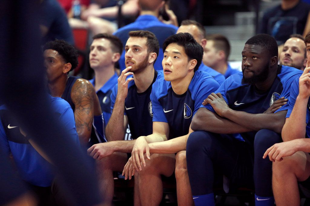 Dallas Mavericks' Yudai Baba, center, watches play from the bench during an NBA summer league basketball game against the Brooklyn Nets, Friday, July 5, 2019, in Las Vegas. (AP Photo/Steve Marcus)
