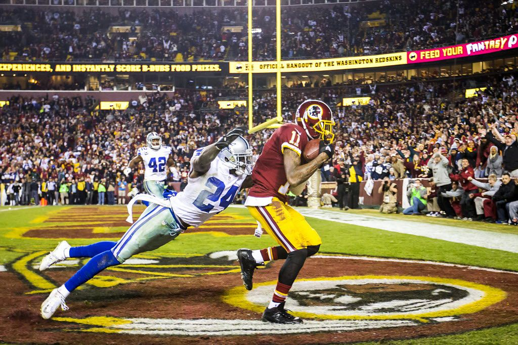Washington Redskins wide receiver DeSean Jackson (11) beats Dallas Cowboys cornerback Morris Claiborne (24) on a 28-yard touchdown pass during the second half of an NFL football game in Landover, Md., Tuesday, Dec. 8, 2015. (Smiley N. Pool/The Dallas Morning News)