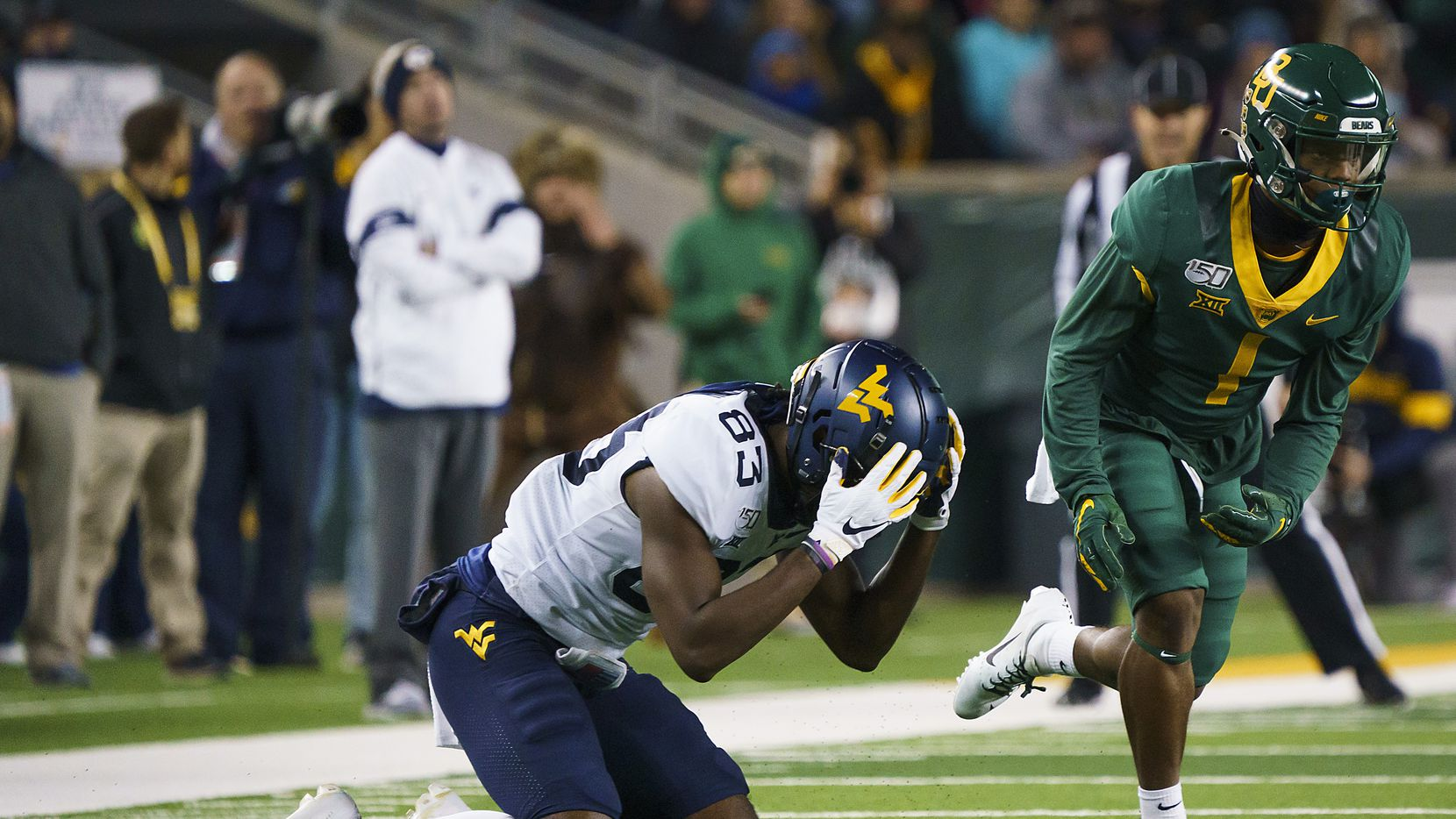 West Virginia wide receiver Bryce Wheaton (83) reacts after missing a pass with Baylor cornerback Grayland Arnold (1) defending during the second half of an NCAA football game at McLane Stadium on Thursday, Oct. 31, 2019, in Waco, Texas.