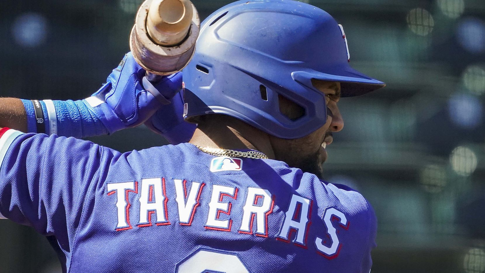 Texas Rangers outfielder Leody Taveras takes a practice swing in the on deck circle before batting during the first inning of a spring training game against the San Francisco Giants at Surprise Stadium on Monday, March 1, 2021, in Surprise, Ariz.