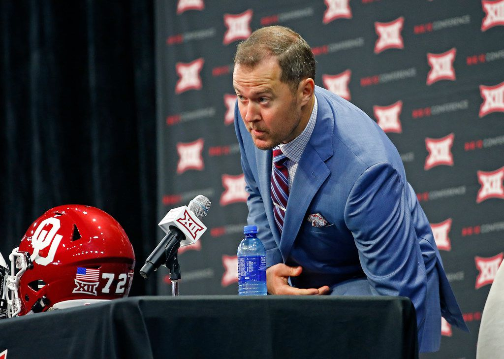 Oklahoma head football coach Lincoln Riley takes a seat during a press conference in Big 12 Media Day at Ford Center at The Star in Frisco, Texas, Monday, July 16, 2018. (Jae S. Lee/The Dallas Morning News)