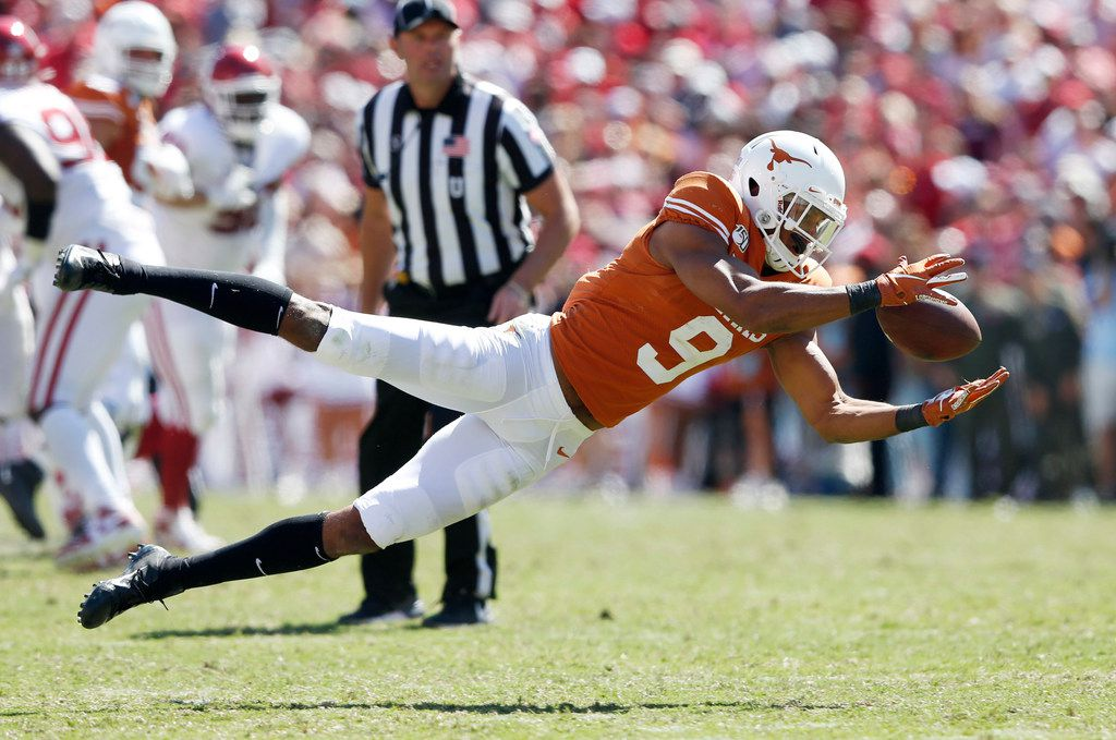Texas Longhorns wide receiver Collin Johnson (9) makes the diving catch on a play during the second half of play in the Red River Showdown at the Cotton Bowl in Dallas on Saturday, October 12, 2019. Oklahoma Sooners defeated Texas Longhorns 34-27. (Vernon Bryant/The Dallas Morning News)
