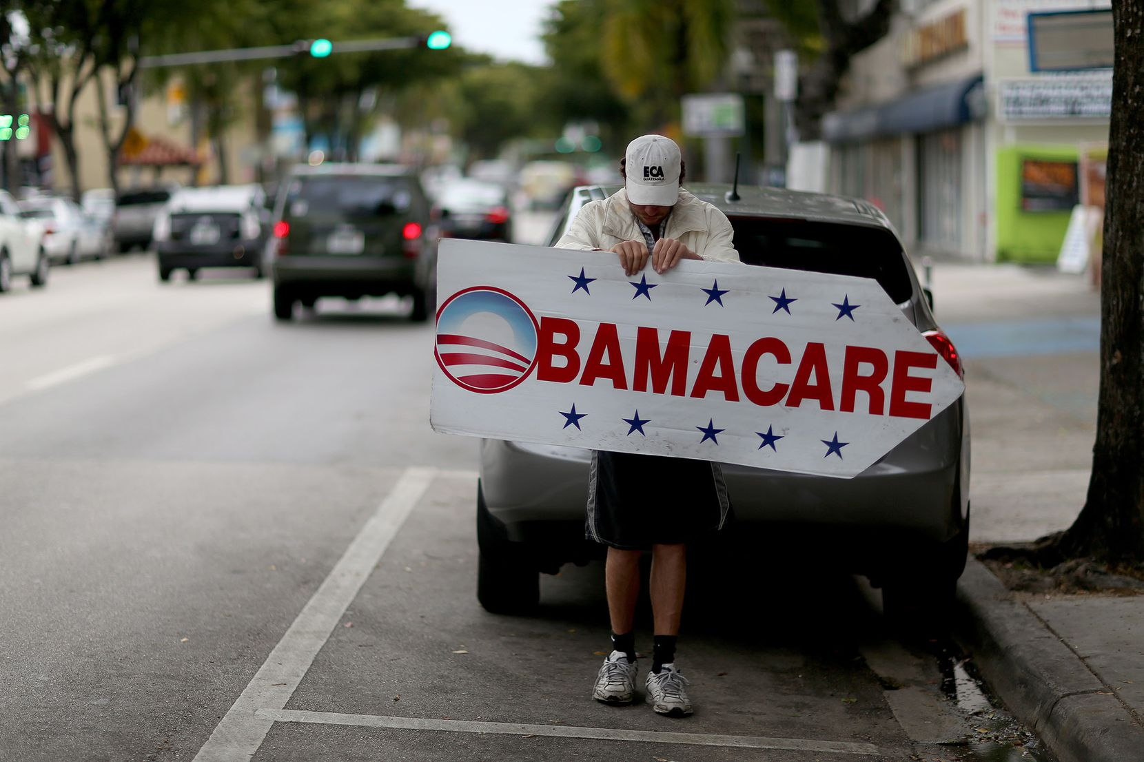 A Miami insurance company advertises to can sign people up for the Affordable Care Act, also known as Obamacare, in 2015. (Joe Raedle/Getty Images/TNS)