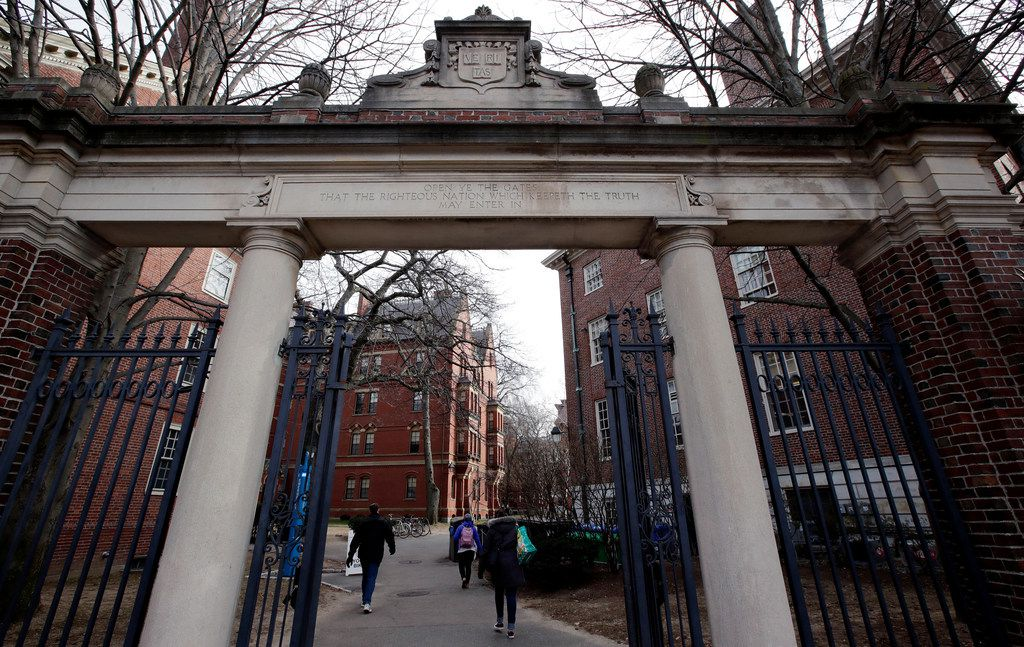 In this Dec. 13, 2018, file photo, a gate opens to the Harvard University campus in Cambridge, Mass.