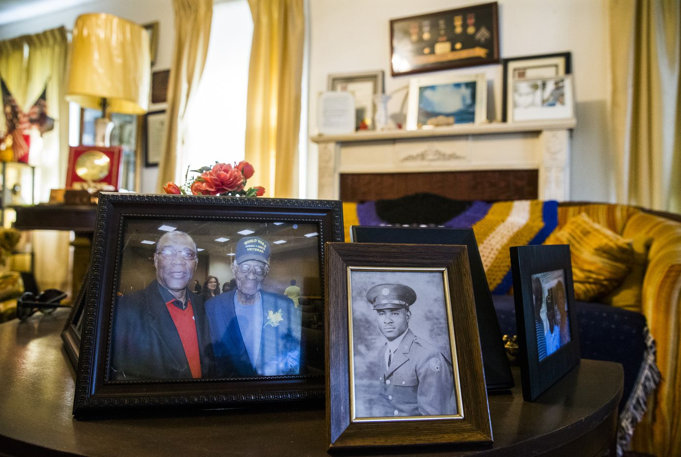 Photographs and other mementos belonging to Richard Overton, 111, are displayed in his home in Austin, Texas. Overton is the oldest living U.S. war veteran.