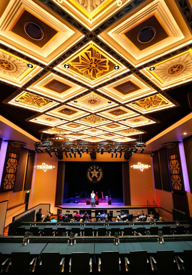 The lighted, hand-painted ceiling is a visual draw as patrons enter the Texan Theater in downtown Greenville on March 25, 2017. Texan Theater owner Barbara Horan figures it cost $7-10 million to restore the historic theater and adjacent cafe.