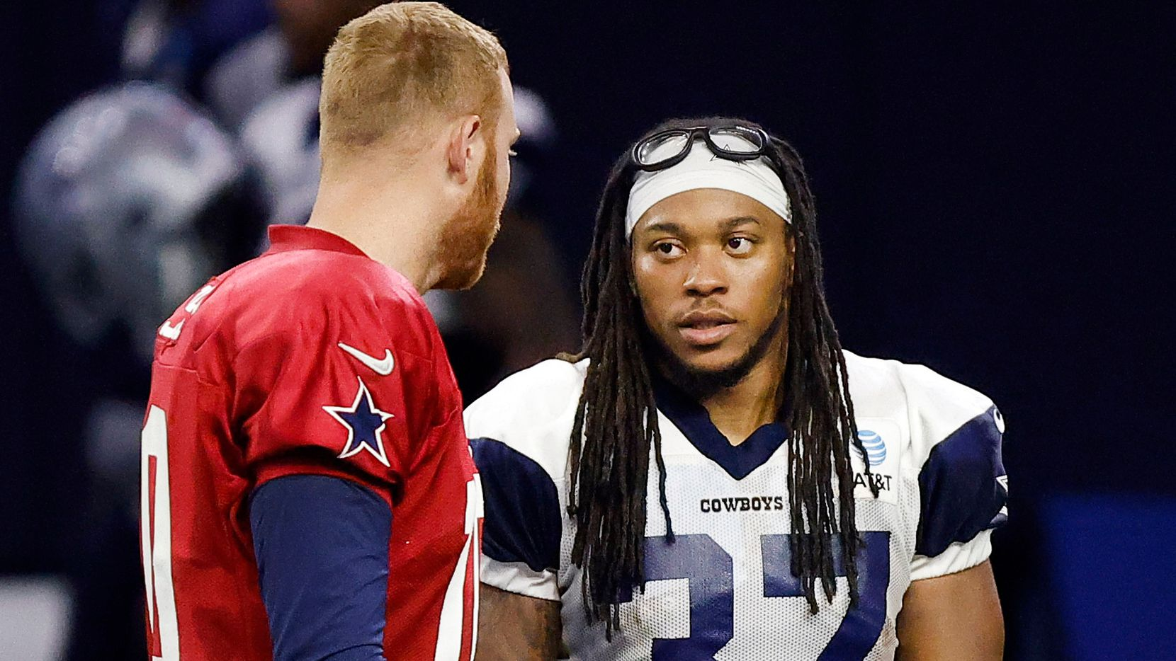 Dallas Cowboys running back JaQuan Hardy (37) visits with Dallas Cowboys quarterback Cooper Rush (10) following Training Camp practice at The Star in Frisco, Texas, Friday, August 27, 2021.