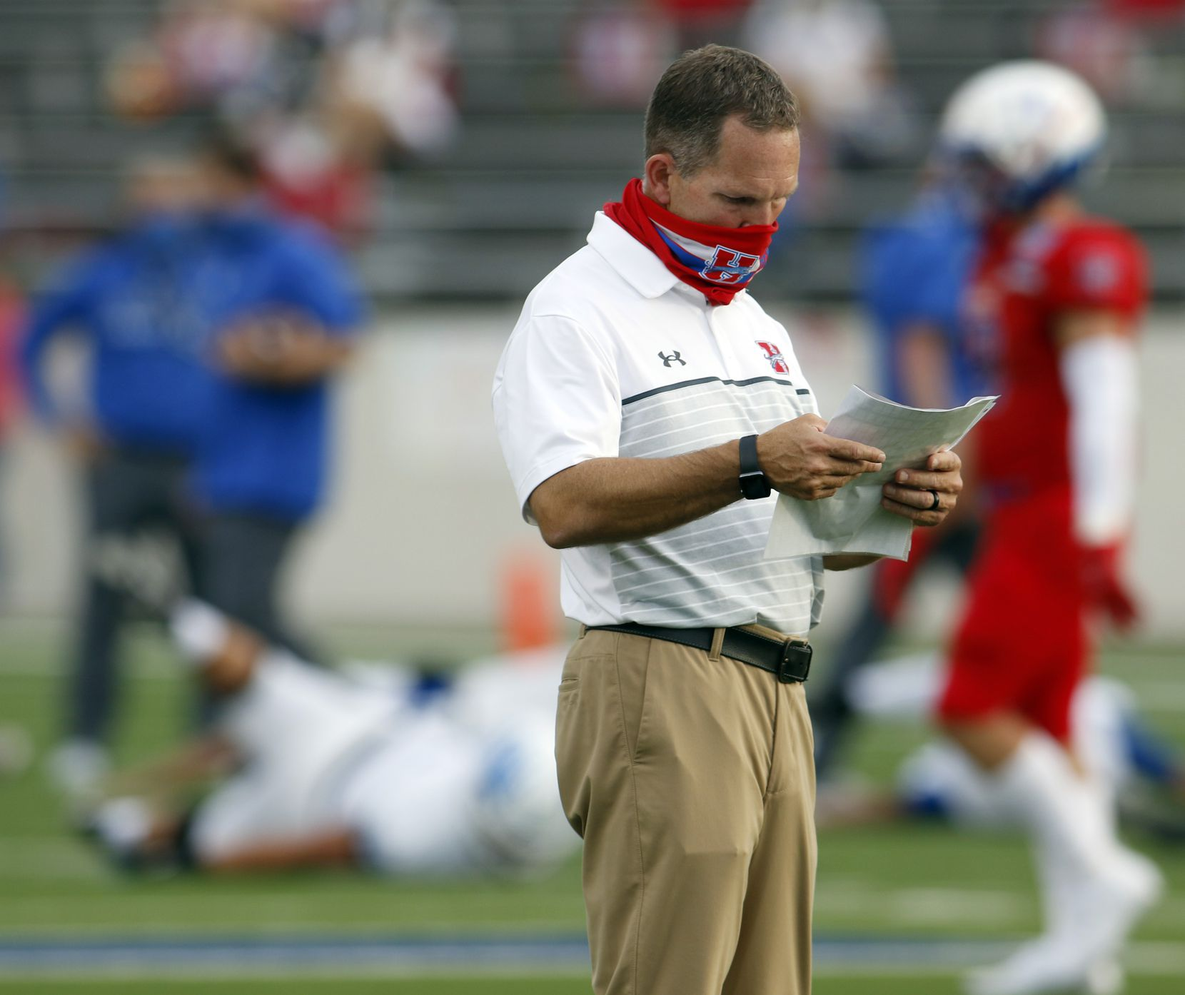 Midlothian Heritage head football coach Lee Wiginton visually peruses his play card during team warm-ups prior to the opening kick-off against Lindale. The two teams played their Class 4A football game at Midlothian ISD Multipurpose Stadium in Midlothian on September 4, 2020. (Steve Hamm/ Special Contributor)