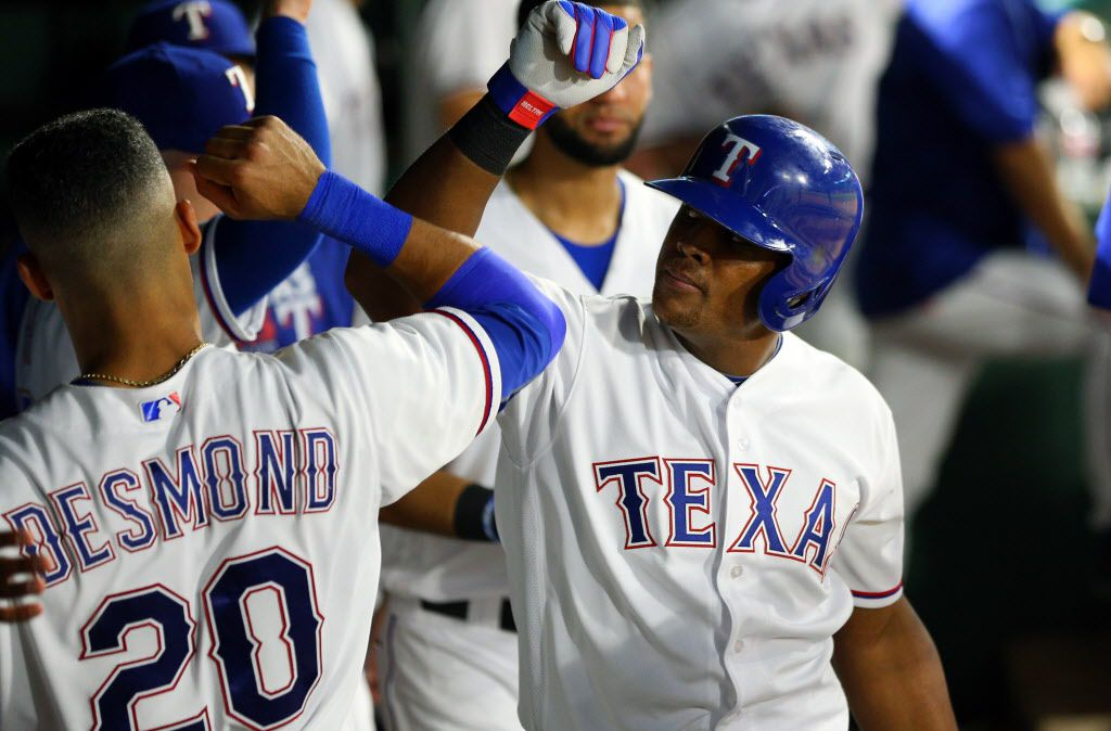 ARLINGTON, TX - AUGUST 26: Adrian Beltre #29 of the Texas Rangers is congratulated by Ian Desmond #20 for hitting a solo home run in the sixth inning against the Cleveland Indians at Globe Life Park in Arlington on August 26, 2016 in Arlington, Texas. (Photo by Rick Yeatts/Getty Images)
