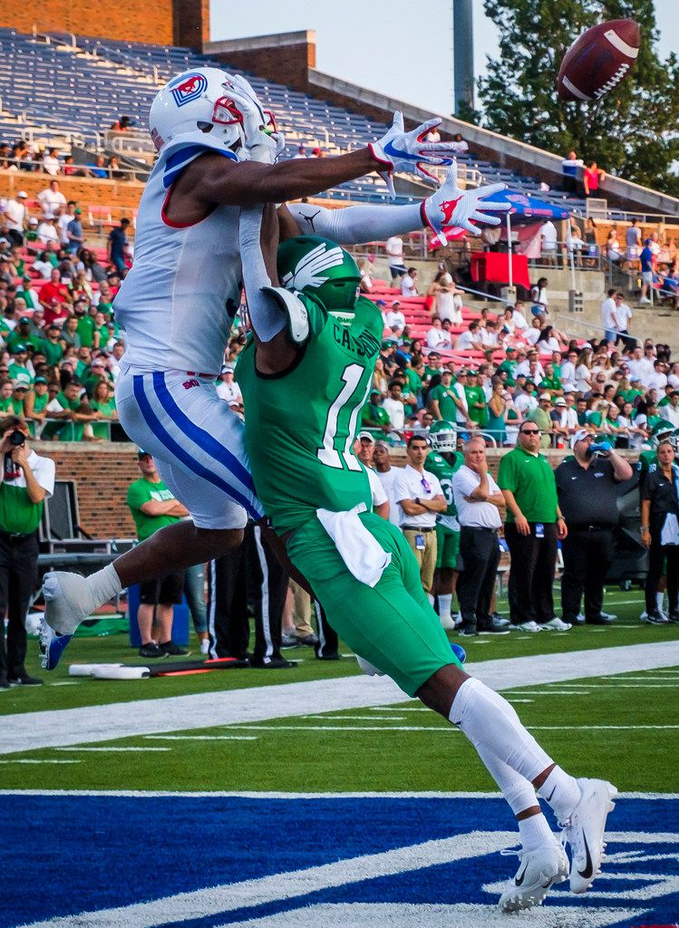 UNT defensive back Cam Johnson (11) breaks up a pass intended for SMU wide receiver James Proche (3) during the first half of an NCAA football game at Ford Stadium on Saturday, Sept. 7, 2019.
