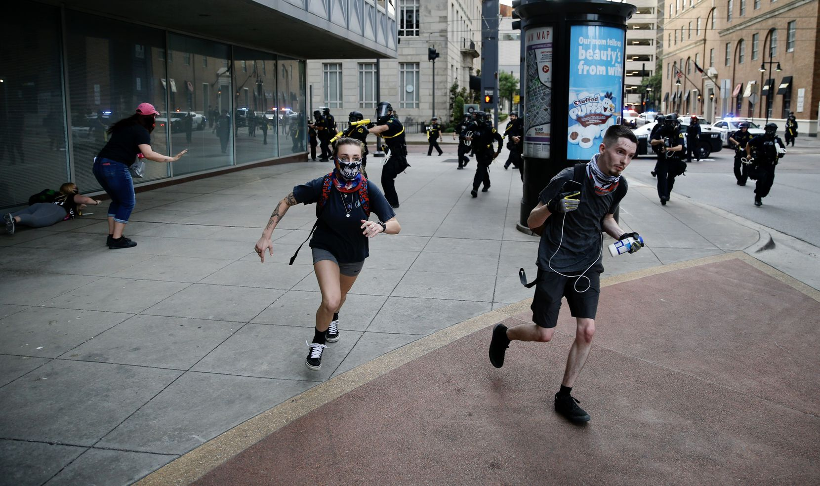 Dallas police made arrests as they cleared out downtown after a 7 p.m. curfew took effect May 31.