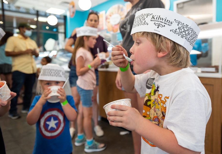 Hendrix Moody, 5, takes a bite of ice cream from Kilwins at Grandscape in The Colony.