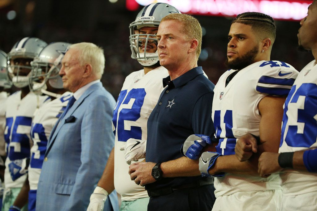 Dallas Cowboys head coach Jason Garrett is locked in arm with teammates before the National Anthem before a National Football League game between the Dallas Cowboys and the Arizona Cardinals at University of Phoenix Stadium in Glendale, Arizona on Monday September 25, 2017. The Dallas Cowboys beat the Arizona Cardinals 28-17. (Andy Jacobsohn/The Dallas Morning News)