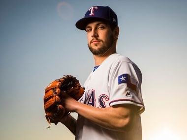 Texas Rangers pitcher Joe Palumbo poses for a photo during Spring Training picture day at the team's training facility on Wednesday, Feb. 21, 2018, in Surprise, Ariz.