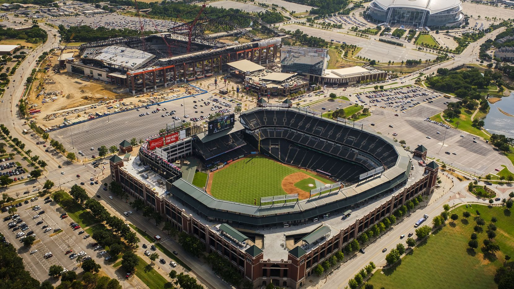 Aerial view of Globe Life Park (bottom), the Texas Live! and Live! by Loews hotel (center), construction of Globe Life Field (left) and AT&T Stadium (top right) last August in Arlington, Texas. The parking lot seen here to the right of Globe Life Park is where the city of Arlington and Loews Hotels & Co. are hoping to build a convention center and hotel. The parking lot to the left of Globe Life Park is where Arlington and the Cordish Companies want to develop a mixed-use/residential project in a public-private partnership.
