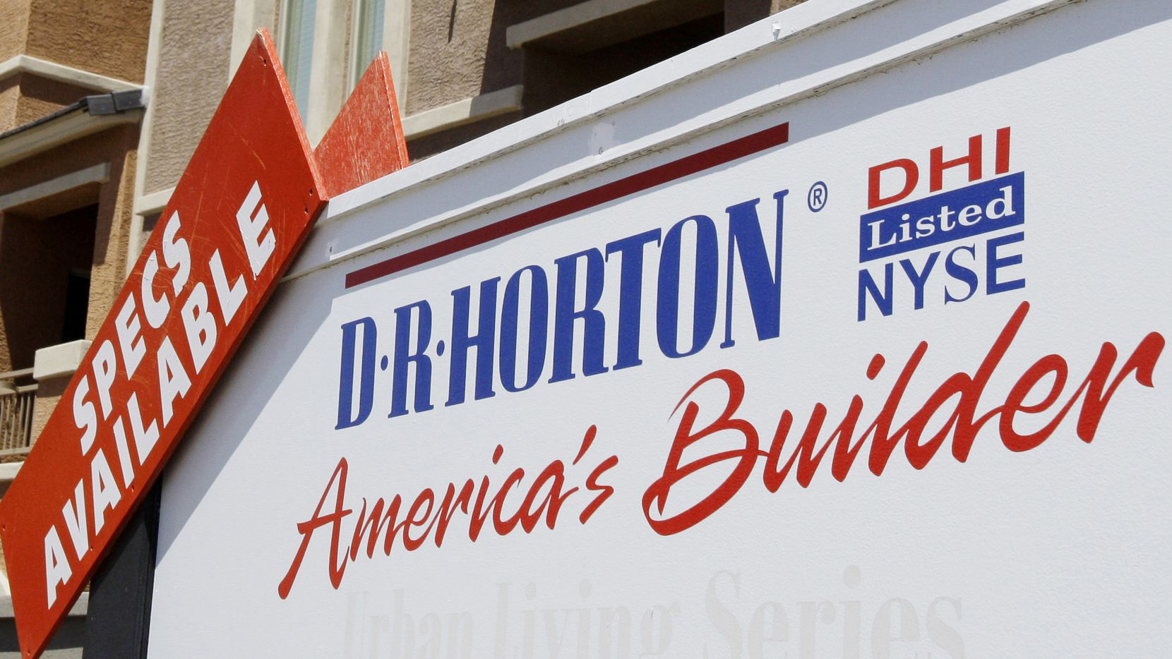 In this May 7, 2009 file photo, a sign advertising homes built by D.R. Horton Inc. is displayed in Chandler, Ariz. The company was founded in Arlington in 1978.