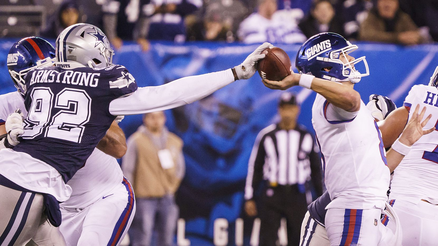 Dallas Cowboys defensive end Dorance Armstrong (92) strips the ball from New York Giants quarterback Daniel Jones (8) for a sack and fumble that was returned for a Cowboys touchdown during the second half of an NFL football game, Monday, Nov. 4, 2019, in East Rutherford, N.J.