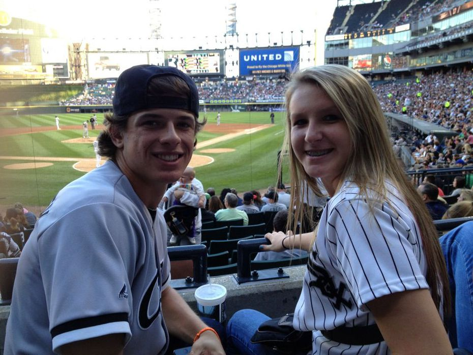 Texas Rangers utility man Nick Solak, left, is pictured in 2013 with sister Alexis at a Chicago White Sox game. (Courtesy/Solak family)