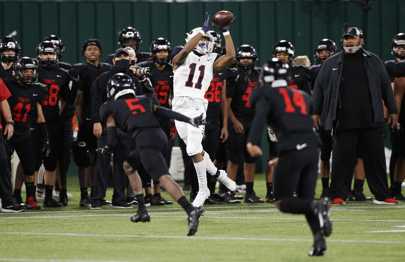 Allen senior wide receiver Jordan Johnson (11) catches a pass as Euless Trinity junior defensive back Jayveus Lyons (5) defends during the first half of a high school Class 6A Division I Region I semifinal football game at Globe Life Park in Arlington, Saturday, December 26, 2020. (Brandon Wade/Special Contributor)