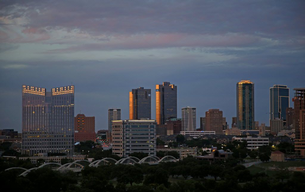 """Part of the Fort Worth skyline at dusk, including the Paul Rudolph designed City Center Towers Complex (center). Famed architect Paul Rudolph designed the two glass and steel towers, which combined, feature 1.5 million-square-feet of office and retail space. He made it his goal to design towers that would dominate the downtown skyline, yet be compatible with the low-rise, historic buildings situated around it. Rudolph accomplished his goal by including an intricate set of architectural features at street level."""""""