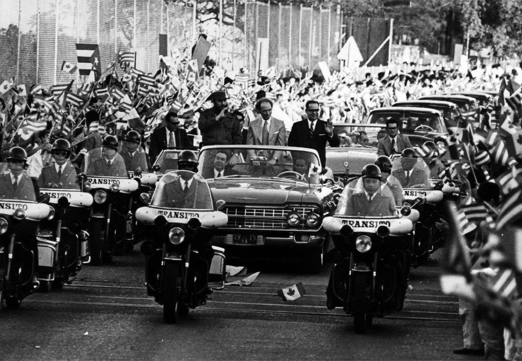 In this Jan. 26, 1976 photo, thousands of Cuban people line the streets in Havava, Cuba to greet Prime Minister Pierre Eliott Trudeau as he drives through the city with Commander in chief Fidel Castro and president of Cuba Osvaldo Dorticos.