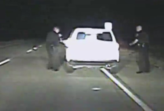 An image from dash-cam video footage showing Strader's vehicle as it begins to pull away from officers.