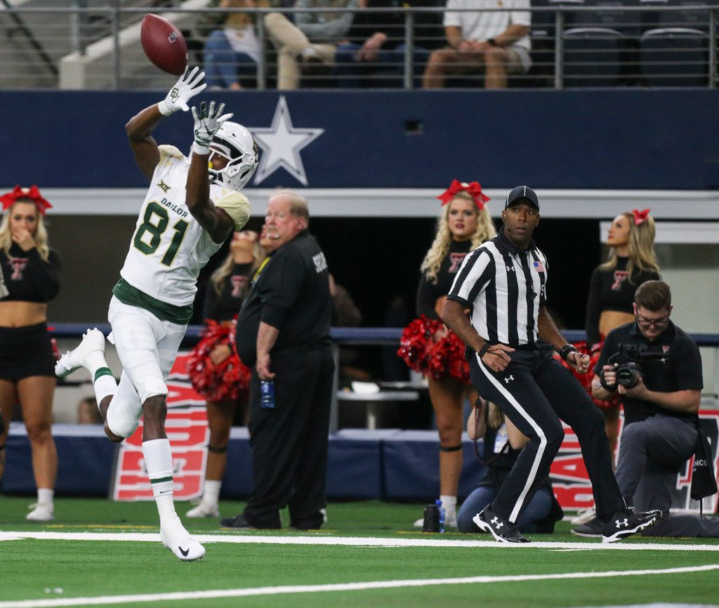FILE - Baylor Bears wide receiver Tyquan Thornton (81) receives a 51 yard touchdown pass during the first half a matchup between Baylor and Texas Tech on Saturday, Nov. 24, 2018 at AT&T Stadium in Arlington, Texas. (Ryan Michalesko/The Dallas Morning News)