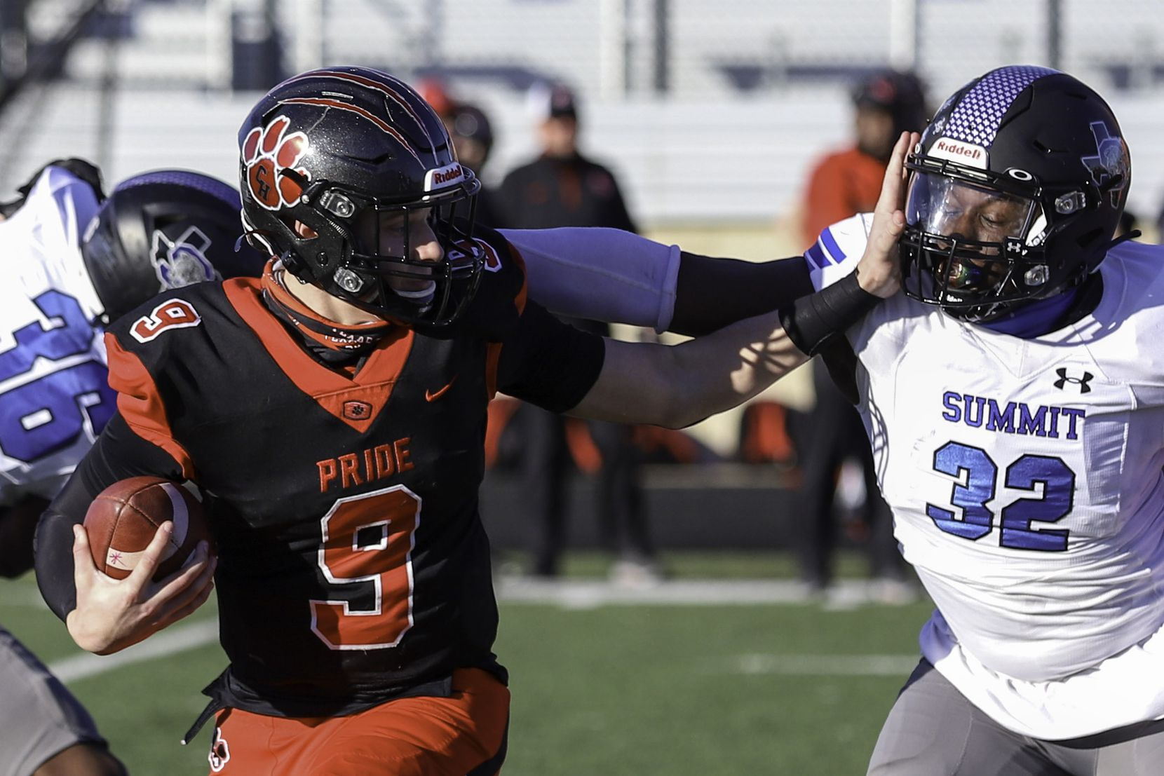 Colleyville Heritage quarterback Brenen Hawkins-Roth (9) gives a stiff-arm to Mansfield Summit's Kalon Duvall (32) during the first half at Bearcat Stadium in Aledo, Texas, Saturday, December 26, 2020. (Elias Valverde II / Special Contributor)