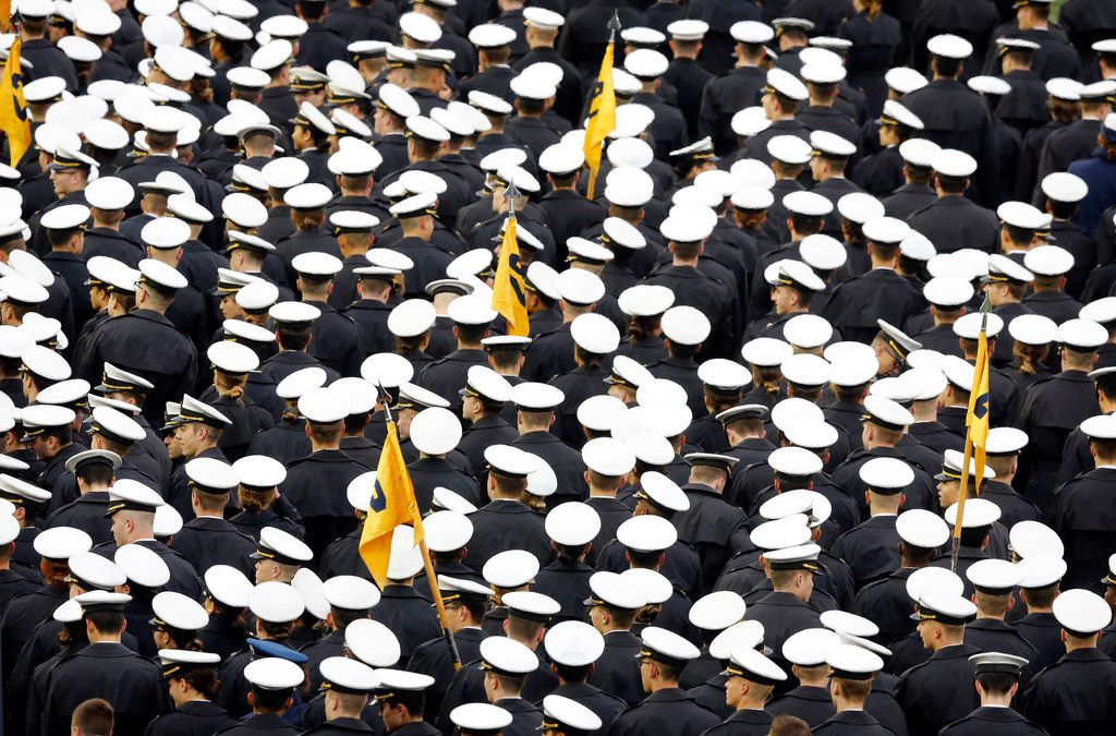 Navy Midshipmen exit the field after pregame ceremonies and the national anthem at Navy-Marine Corps Memorial Stadium in Annapolis, Maryland, Saturday, November 23, 2019. The Navy Midshipmen were facing the Southern Methodist Mustangs. (Tom Fox/The Dallas Morning News)