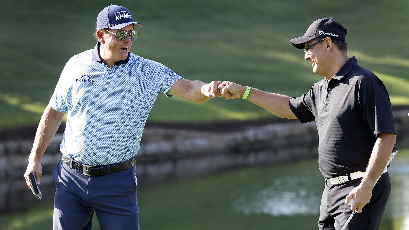 Golfer Phil Mickelson (left) gives a fist bump to playing partner Edgar Guevara after his clutch putt on No. 16 during the Charles Schwab Challenge Colonial Pro-Am at the Colonial Country Club in Fort Worth, Wednesday, May 26, 2021. Mickelson kept his commitment to play in the tourney after winning the PGA Championship last week. (Tom Fox/The Dallas Morning News)