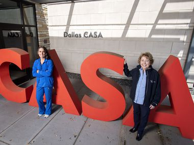 Dallas CASA volunteer Hannah Pearson (left), who is also a nurse treating COVID-19 patients at Parkland Memorial Hospital, with Kathleen LaValle, Dallas CASA president and CEO, outside the nonprofit's headquarters.