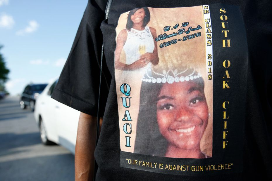 A family friend of NeQuacia Jacobs wears a shirt in her memory after South Oak Cliff High School's graduation ceremony.