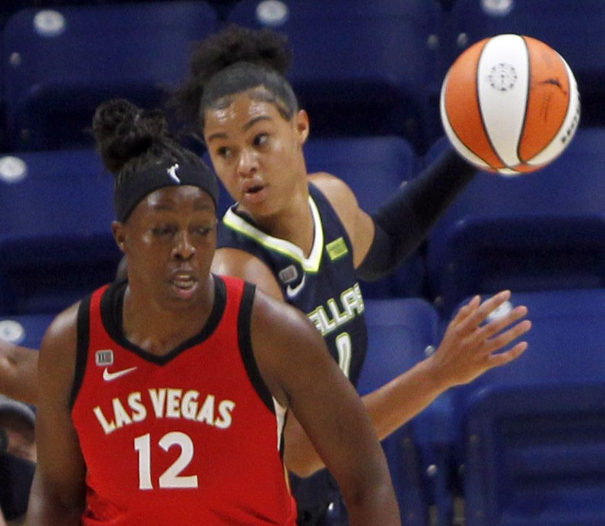 Dallas Wings forward Satou Sabally (0) looks to pass after slipping behind the defense of Las Vegas guard Chelsea Gray (12) during first half action. The two WNBA teams played their game at College Park Center on the campus of UT-Arlington on July 11, 2021. (Steve Hamm/ Special Contributor)