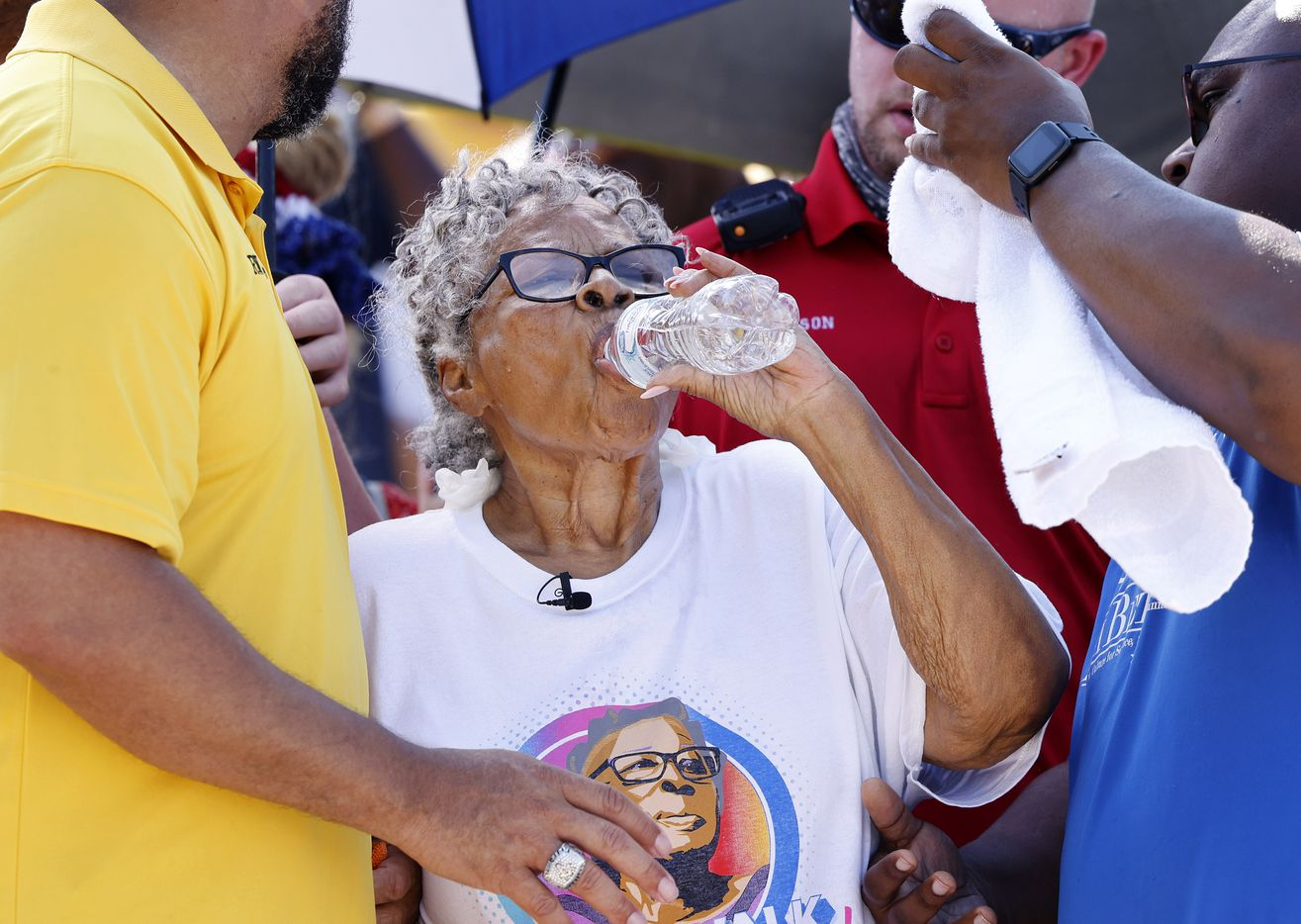 Opal Lee made several water and cooling stops as she received a shaded escort during her hot trek through downtown Fort Worth, Saturday morning, June 19, 2021.