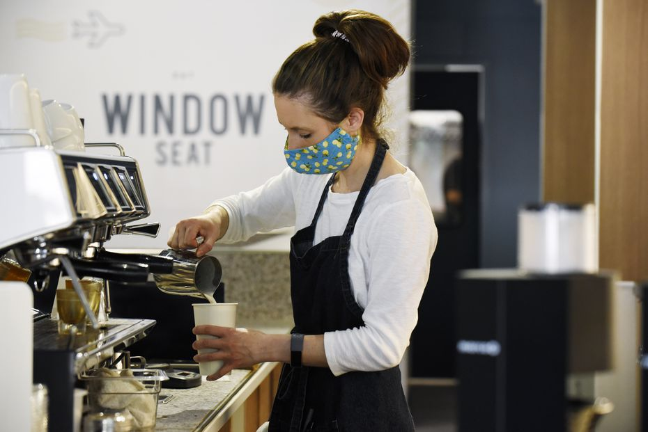 Kristen Boyd prepares drinks for customers at Window Seat coffee shop in Dallas. It opened in March on Greenville Avenue.