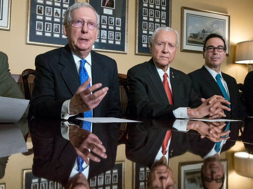 In this Nov. 9, 2017, file photo, from left, Senate Majority Leader Mitch McConnell, R-Ky., Senate Finance Committee Chairman Orrin Hatch, R-Utah, and Treasury Secretary Steven Mnuchin, speak to reporters on Nov. 9.