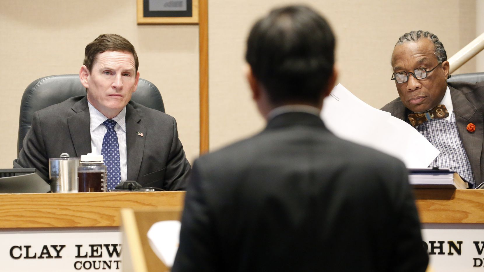 Dallas County Judge Clay Jenkins (left) and Commissioner John Wiley Price (right) listen to Dallas County Health Department director Dr. Philip Huang presents information about the coronavirus at the Dallas County Commissioner Court in Dallas, Tuesday, February 4, 2020.